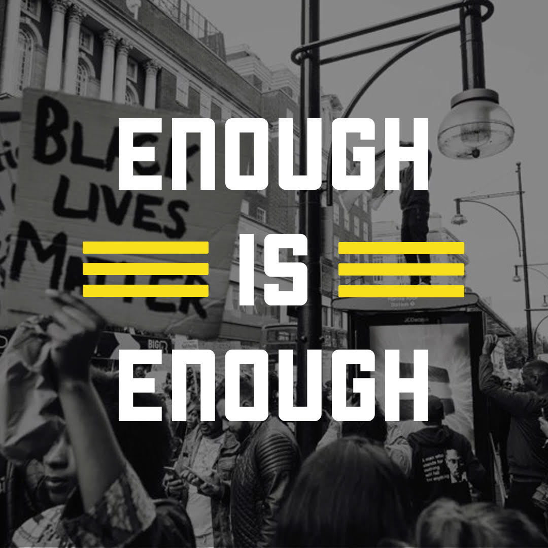 "White bold text reading ""enough is enough"" in all caps overlaying a black and white photograph of people at a protest holding a sign that reads Black Lives Matter"